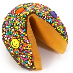 Dark Chocolate covered giant fortune cookie with colorful stars and smiley faces