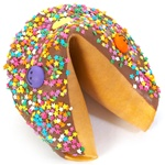 Milk Chocolate covered giant fortune cookie with colorful stars and smiley faces