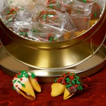 Traditional vanilla flavored fortune cookies covered in assorted chocolates and festive holiday springles perfect for the corporate gift season!
