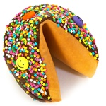 Dark Chocolate covered giant fortune cookie decorated with colorful stars and fun smiley faces