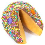 Milk Chocolate covered giant fortune cookie decorated with colorful stars and fun smiley faces