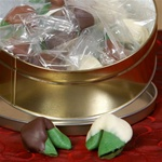 Green fortune cookies covered in milk, white and dark chocolate, the perfect gift for passing along the luck of the Irish