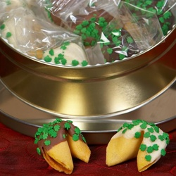 Traditional vanilla fortune cookies chocolate covered and dressed with lucky shamrocks.